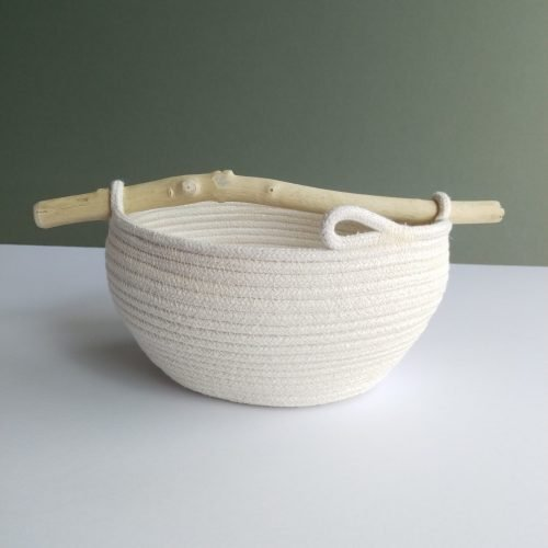 small coiled rope bowl with curved sides and a light colour driftwood handle