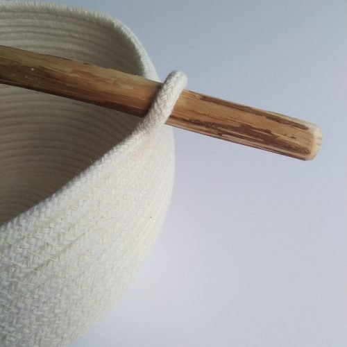 a closer image showing the driftwood handle as it connects to the coiled rope bowl