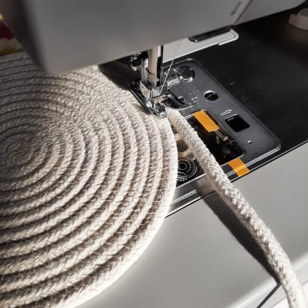 A coiled rope placemat being made on the sewing machine.